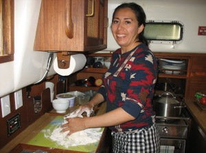 Charito making bread