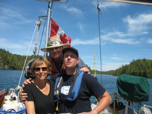 Darcee, Nick and Ian sailing in Hakai